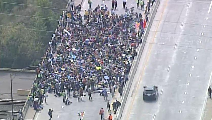 #BlackLivesMatter protesters lying down on the bridge. | LIVE AERIALS: http://t.co/R5VELbwG2R #BlackFair http://t.co/arTkl3Q8I3