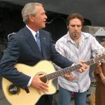 Day 2 of flooded New Orleans: Prez Bush in SoCal, playing air guitar w/country singer Mark Wills, #KatrinaBook http://t.co/jToeq5qj6E