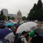Happening Now in #Tokyo In spite of rain, 120,000+ people protest Abes security policies. #Japan @SEALDs_Eng http://t.co/156JiU7SrZ