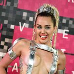 Host @MileyCyrus reveals all as she arrives at the #MTVVMAs. http://t.co/6DzPP2lisM