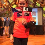 Sam Cooper, 10, from Ngaio School with the four flags. His fav is the Koru or silver fern on black and blue @NZStuff http://t.co/51WrYWFGmw