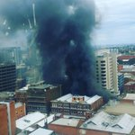 BREAKING: Firefighters fearful of building collapse & people trapped on the roof of the building near the city blaze http://t.co/xOQPwnMQNP