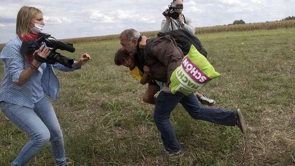 The father/son refugee who were kicked by a reporter. Remember? They got to Germany safe and secure #SyrianRefugees http://t.co/wNC8JWCg4I