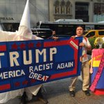 People dressed up as KKK outside Trump Tower. This man said he is from Mexico and this is to protest Trump http://t.co/IeIFNq07IH