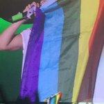 Harry holding up a rainbow flag in Buffalo last night http://t.co/aOupWdElja