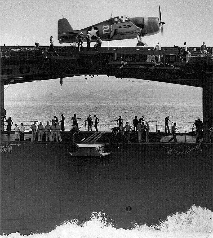 starboard view of uss yorktown with a vf1 f6f3 hellcat