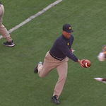 Of course Jim Harbaugh warmed up with his Michigan players before the game http://t.co/fj5yQw8BcP http://t.co/gRWtLcWvGg
