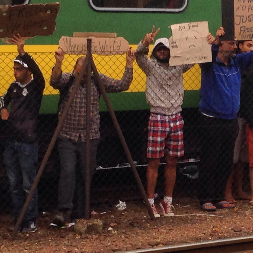 "#Refugee outside the #train in #Bicske #Hungary holds up sign asking ""Where is the World?"" http://t.co/zR08ePD13y"