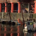 The scene at #Liverpools Albert Dock where the tall ship The Zebu has sunk. http://t.co/glgk7M0FR0