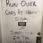 Graffiti, promoting #police violence on a store door in #ATX. More @ http://t.co/j3WTYnKKlH @ArtAcevedo #BackTheBlue http://t.co/87JfAsQjbp