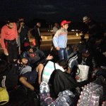 On the motorway from Budapest #migrants settle down for the night #migrantcrisis http://t.co/6gnsmFd9Au