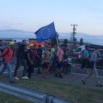 The marchers on the motorway. Walking from Budapest to Austria waving the EU flag. http://t.co/0lURczRNHP