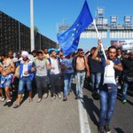 Man waving EU-flag leading the march to #Austria from #budapest #hungary Watch it in video: http://t.co/XXuJTXwPyI http://t.co/L79FAMvD7J