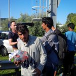 Volunteers hand out water to 1000s of #refugees walking on main highway from #budapest #hungary to #vienna #austria http://t.co/pSpuabRgZS