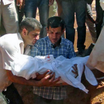 Another wrenching photo: Aylan Kurdis father buries him in Kobani today @ABarnardNYT reports http://t.co/VLXmPvDy1F http://t.co/HZPeOa3BW1