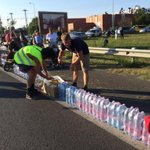volunteers lining up water and food by the road. a side of Hungary these refugees and migrants havent seen much of http://t.co/aT8B7RqNDi