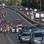 PHOTOS: Hundreds of migrants set off on foot from Budapest for Austria. http://t.co/de5iRzXgCA http://t.co/rsktmx3CEf