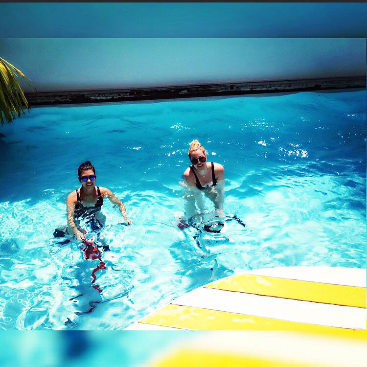 #FBF with my little workout buddy @kourtneykardash in St Bart's! Yes we did spin class in the pool. http://t.co/E2OJKxHGbK