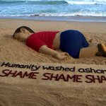 An Indian artist works on a sand sculpture depicting drowned Syrian kid Aylan Kurdi. http://t.co/3DF1TED3mU