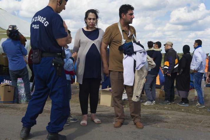 Najibah, 7 months pregnant, walked for 8 days to get to #Hungary #europecrisis http://t.co/JgJDq7CWlO http://t.co/pBjSkWMtXB