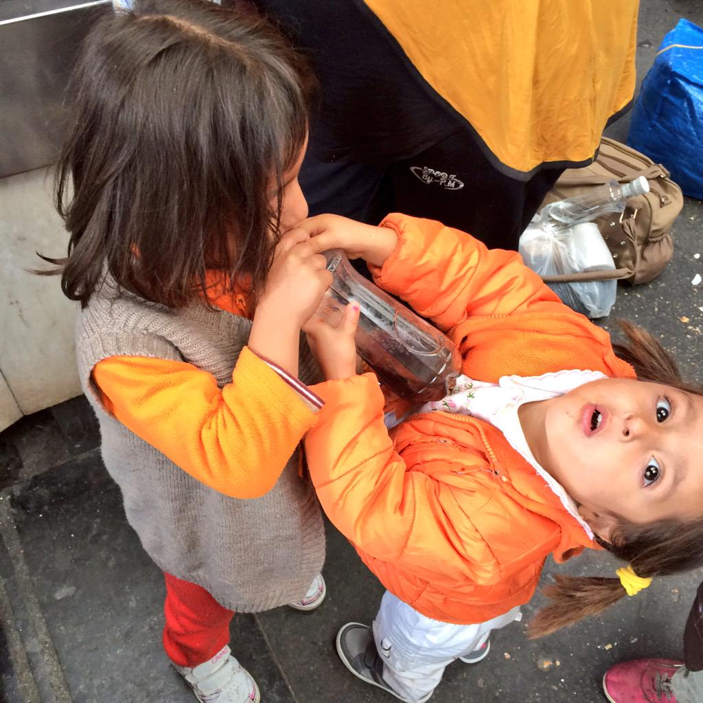 When you help your sister drink soda. Not pictured: sister's shirt covered in soda. These two from #Kobani. #Refugees http://t.co/KQTS77aRTC