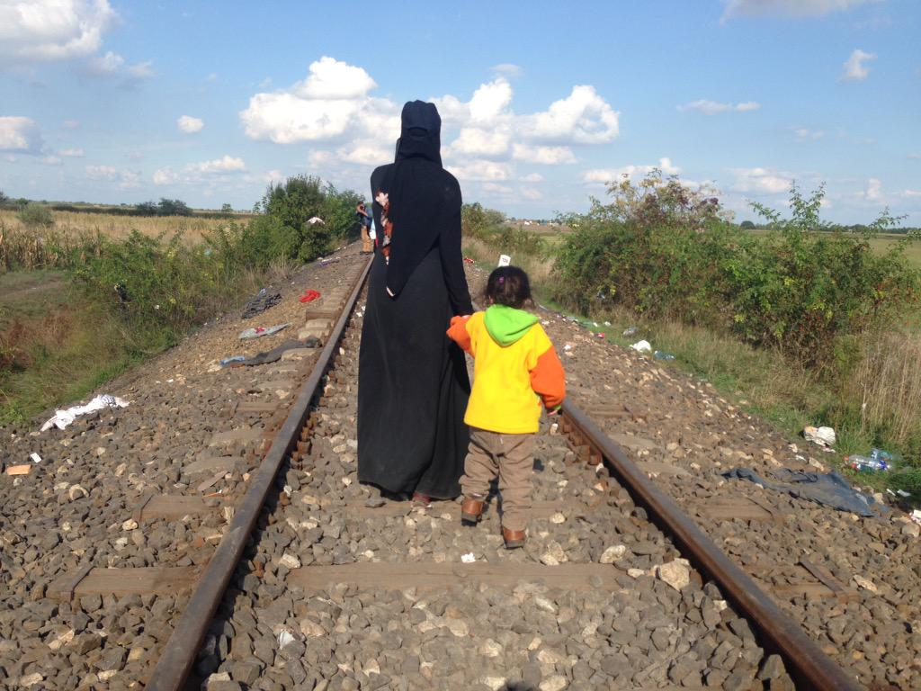 Young #Syria-n #refugee Jana & her mom as they walk on railroad, having just entered #Hungary from #Serbia @AJEnglish http://t.co/twvZvzTjpU