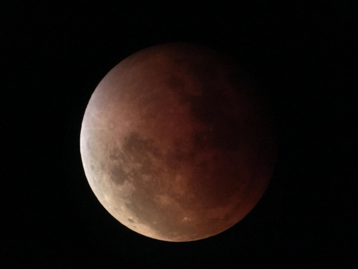 Seattle's weather is being unusually cooperative tonight. Managed to get a good photo of the eclipse: http://t.co/8LLyqT693o
