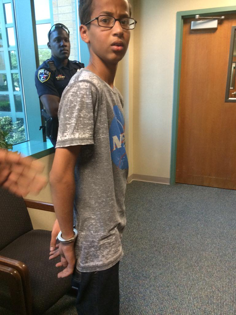 WTF: Bright kid makes clock, school thinks it's bomb. ARRESTED & CUFFED (in NASA shirt no less) http://t.co/NVbf4OR358 #HelpAhmedMake