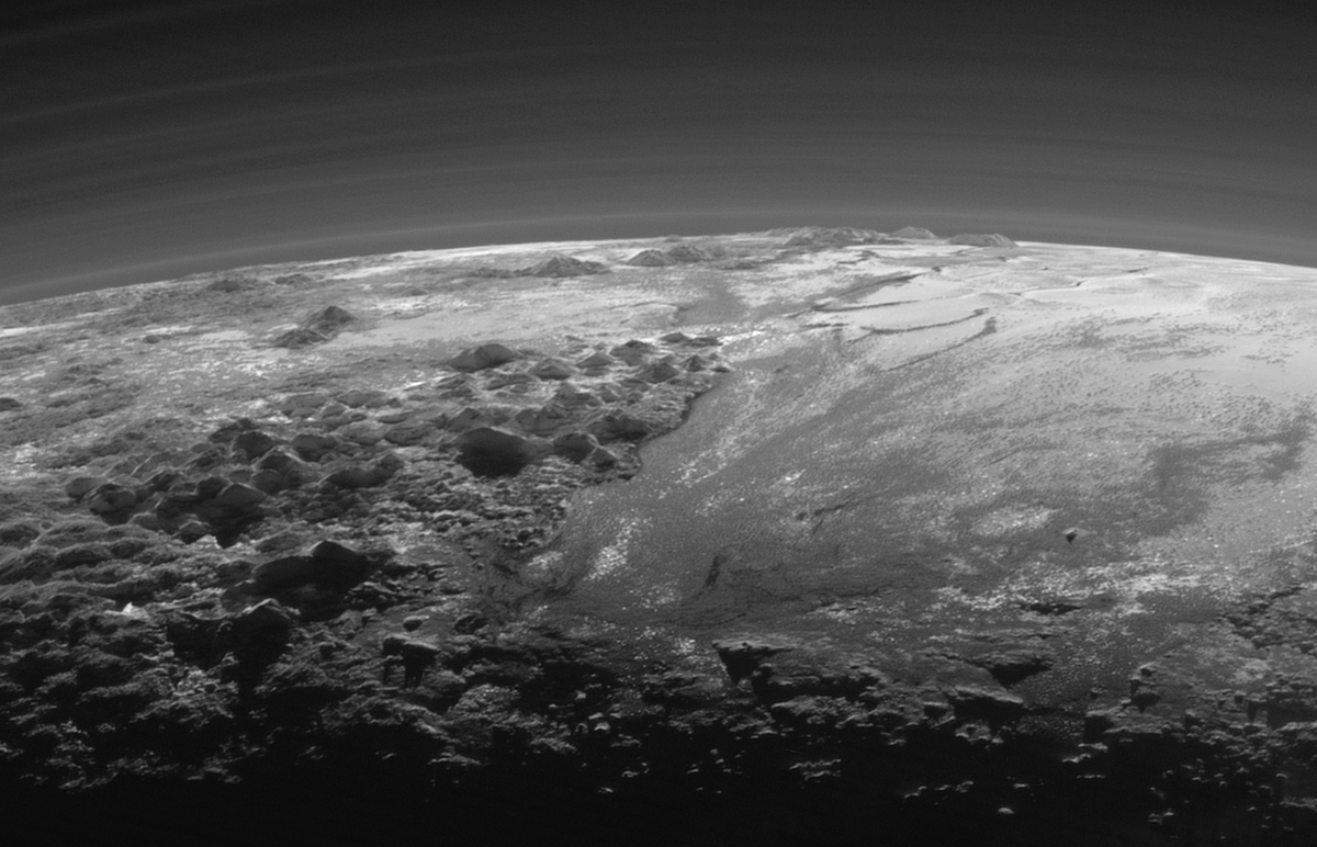 OMG you guys. Stunning new photos of Pluto finally downloaded from New Horizons. http://t.co/UrguRXFTUy http://t.co/Hk5lP1oNGo