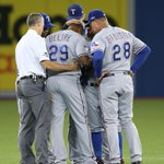 The guys rally around Beltre before being removed from the game with lower back stiffness. http://t.co/aUItjLasqi