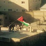 #Palestinians Raising the Palestinian flag in Shufat refugee camp in #Jerusalem Dose it remind you of something? http://t.co/kZia59XqXK