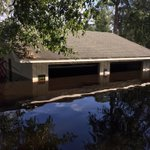Took a boat ride down the river filled streets of Lees Landing. Check out this garage almost completely under water! http://t.co/KPRS4khSTO