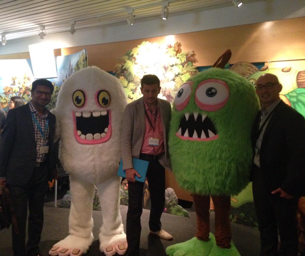 Big Blue Bubble is at #GameONVentures! @vikaskgupta, Damir Slogar & @Big_Blue_Bryan pose with the @SingingMonsters! http://t.co/AUU56ezRe3