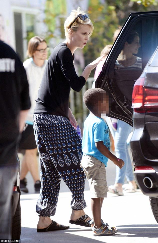 Charlize Theron Keeps It Casual For A Day Out With Her Son Jackson