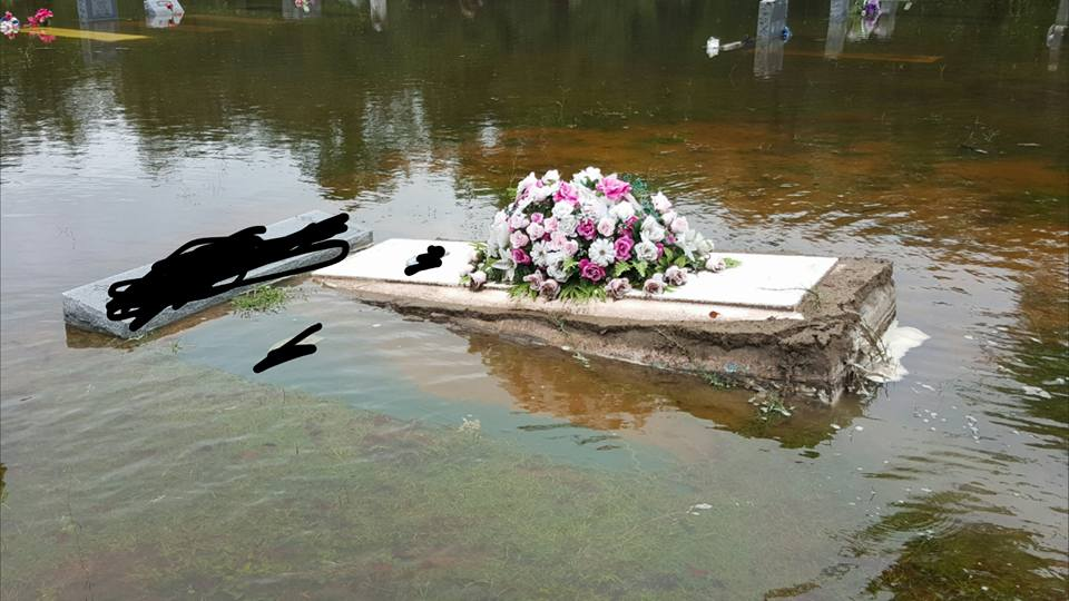 caskets are seen floating to the surface in charleston flood