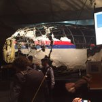 Whats left of the outer body of #mh17 shows shrapnel puncture marks centred around cockpit. Nose cone missing. http://t.co/CEf5iiYekC