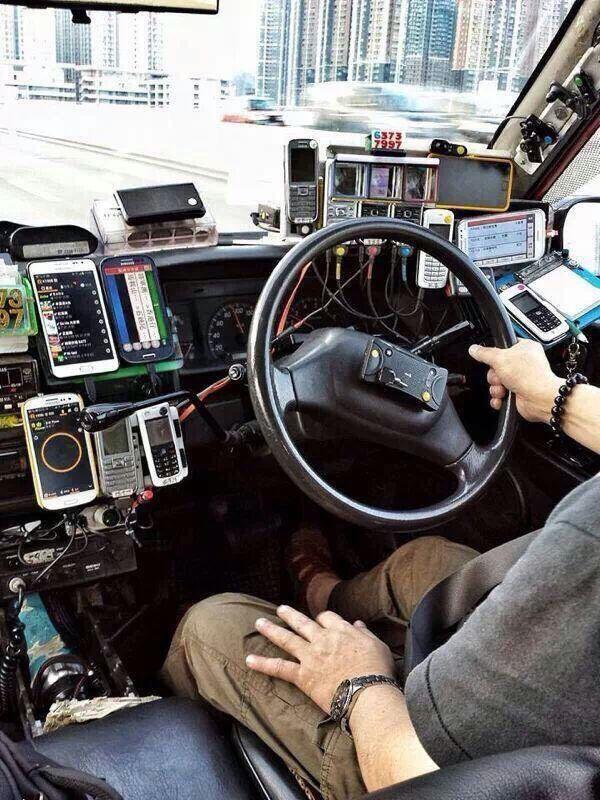 This Hong Kong cab driver is apparently a cyberpunk (cellpunk?). But what are the phones for? http://t.co/UDHfDtgsww