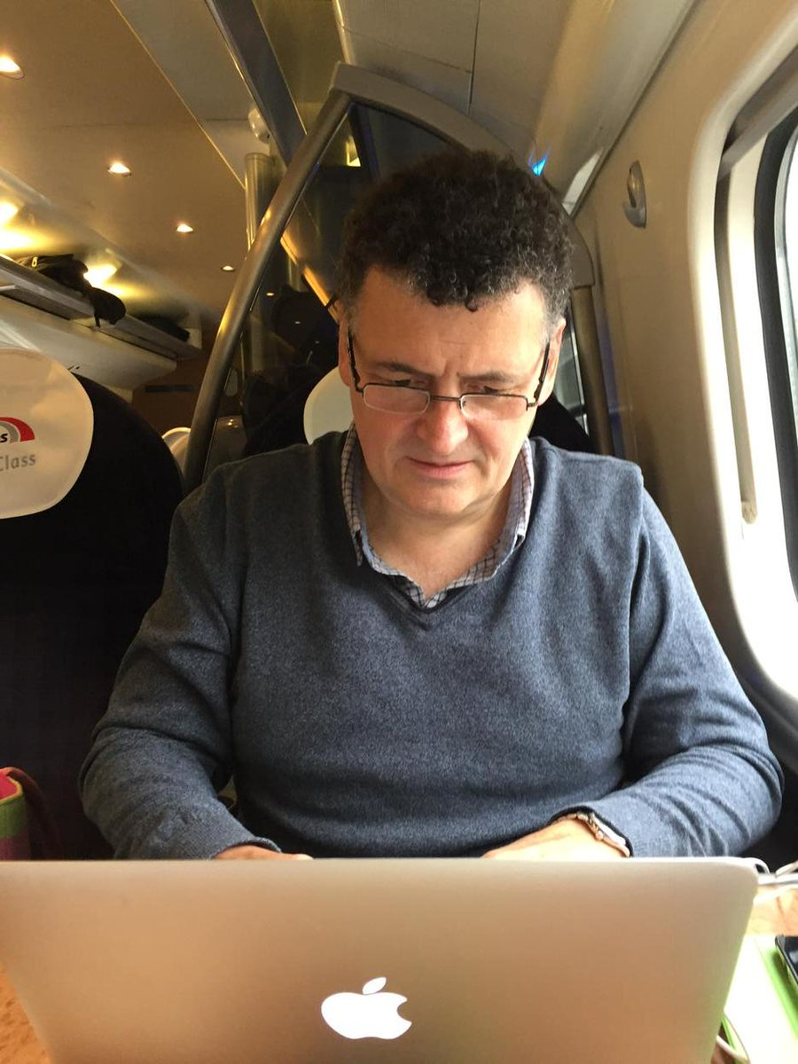 This is what a man writing a #Sherlock S4 script on a train looks like. http://t.co/f7yClZbwR1