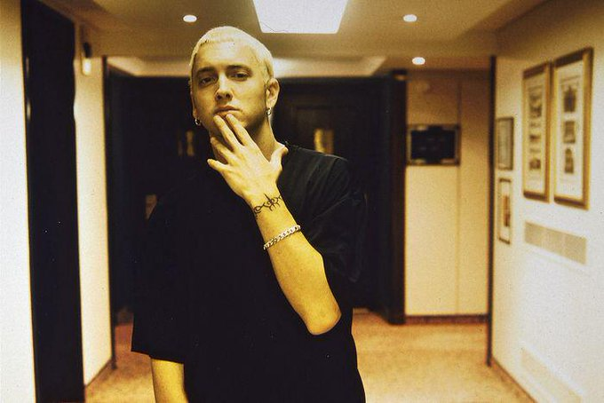 Wish a happy 43rd birthday! Check out these 15 old school Marshall Mathers photos:
