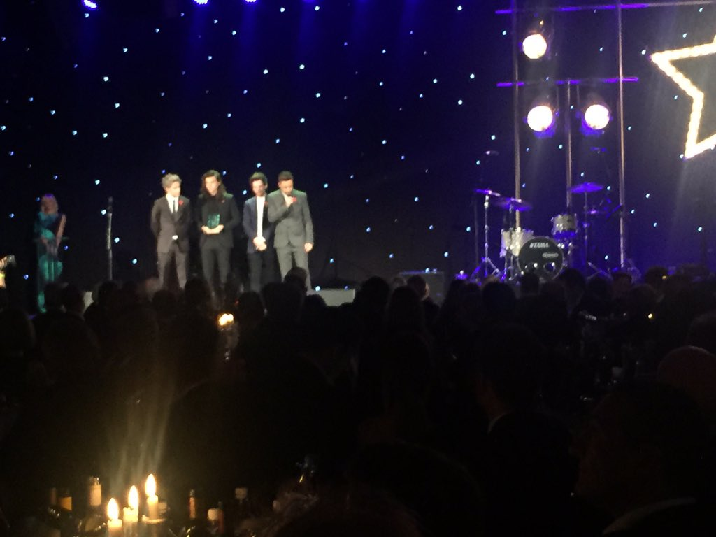 The cat's out of the bag. Presenting @SimonCowell with his #MITS2015 award are @onedirection https://t.co/lGgzRXlTfI