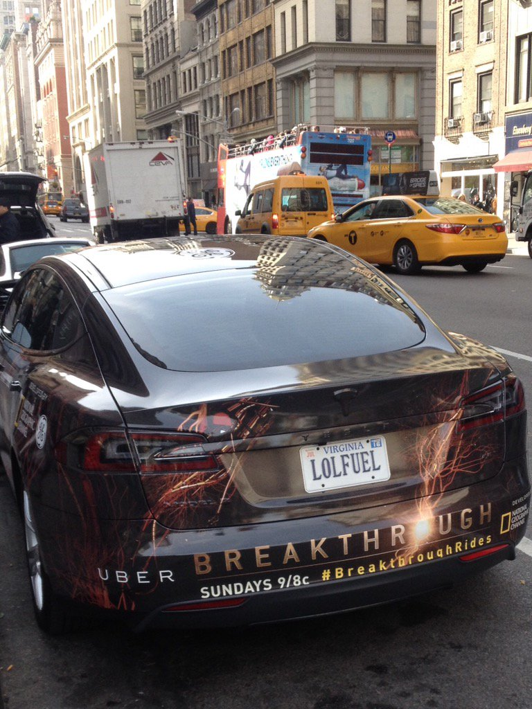 """A Tesla parked on 5th Ave with the license plate """"LOLFUEL"""" https://t.co/BRGS2Cktx4"""