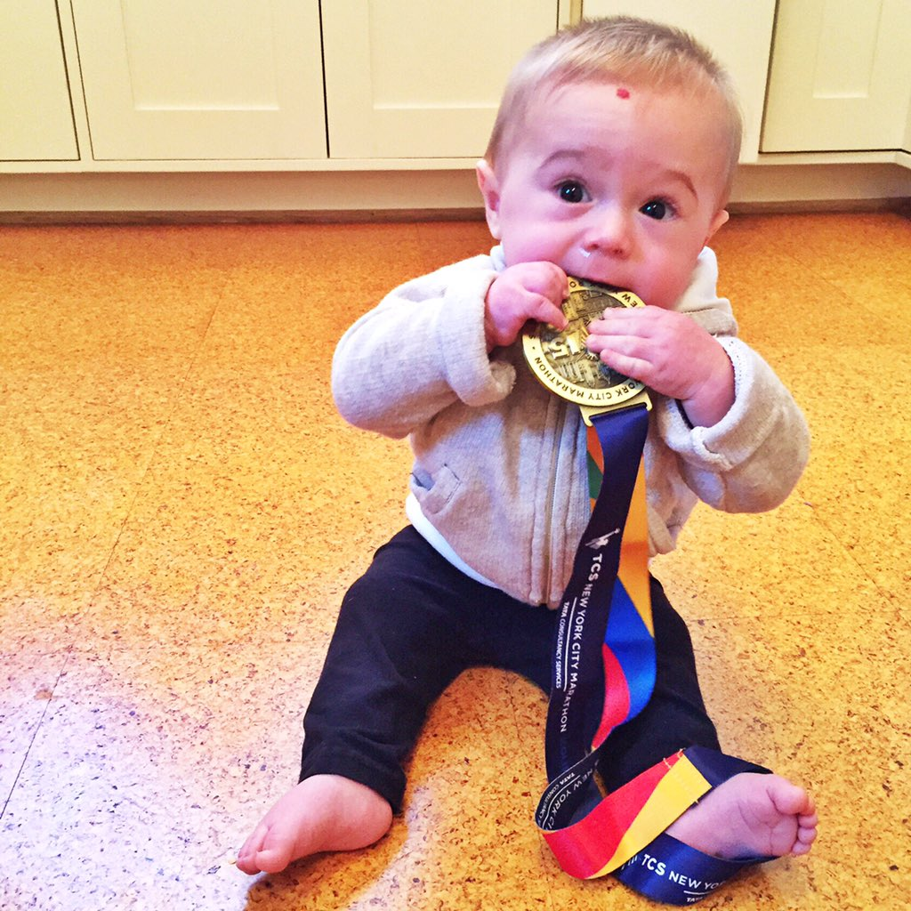 @nycmarathon my son loves the medal, and he instinctively knew what you do with it, https://t.co/DFHOgW9gIt
