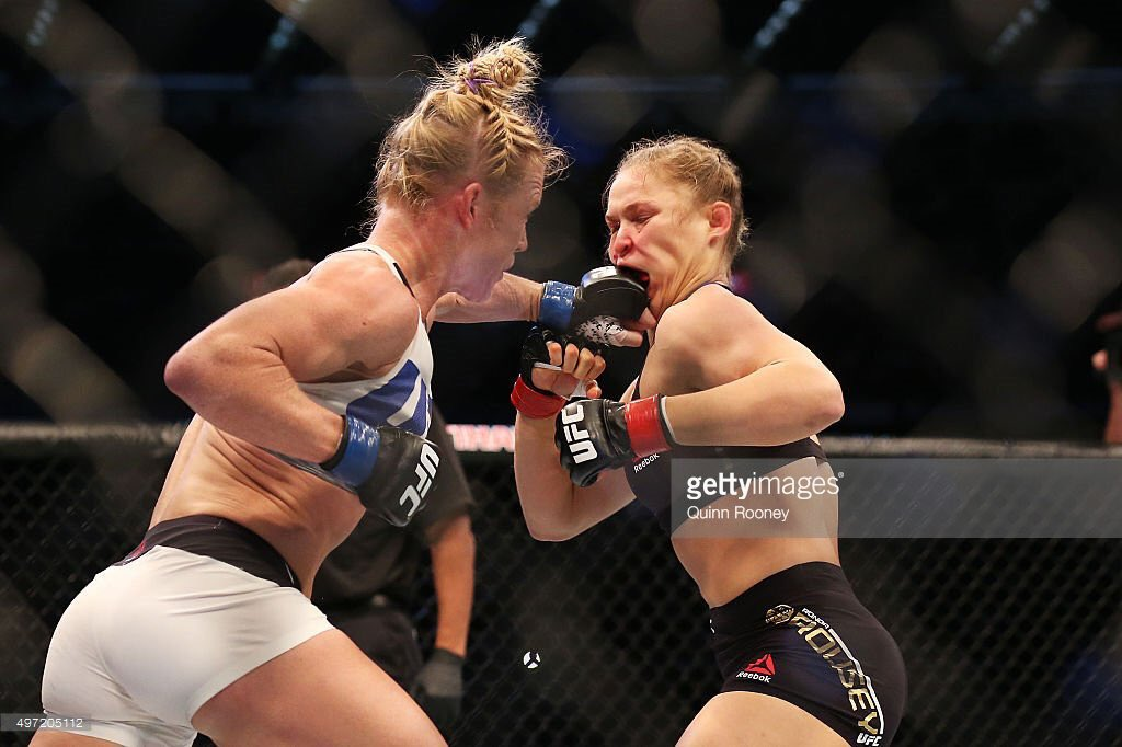 "I believe this is the definition of a ""knuckle sandwich"". Oh my. h/t @GettySport #UFC193 https://t.co/EUizxNDkGy"