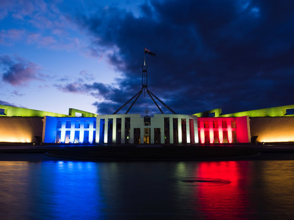Parliament House in Canberra bathed in the colours of the French flag. https://t.co/NIQYAH3Avb