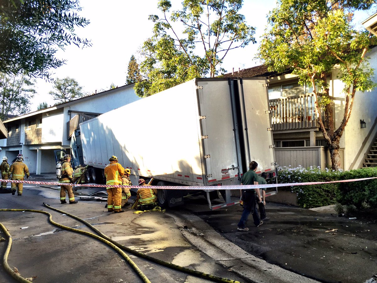 Photo crews working to stabilize building after semi truck crashes into apartment building in Garden grove breaking news now