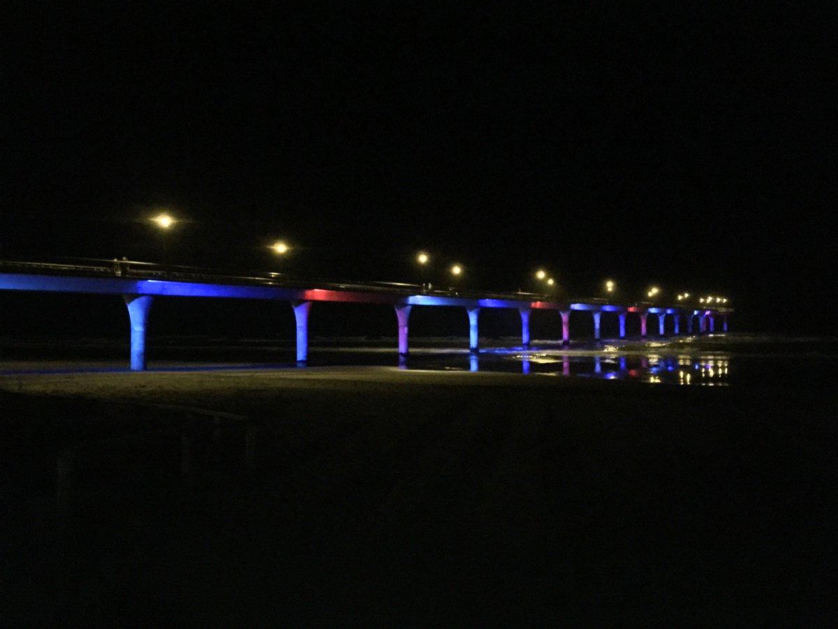 New Brighton Pier in #Christchurch lit up in red, white & blue in support of Paris #PrayForParis #LoveToParis #chch https://t.co/CzW7Jqk1W8
