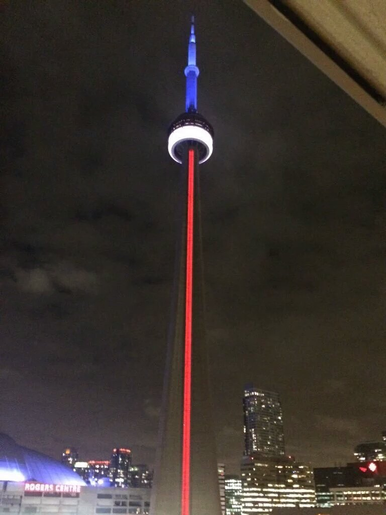 #Toronto landmarks lit up in blue, white & red tonight. Nathan Phillips Square vigil for #Paris @ 2pm. #ParisAttacks https://t.co/xYTSdMoBCs