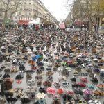 Thats a lot of shoes!! Banned from marching Parisians sent in thousands of pairs to take part in the #ClimateMarch https://t.co/jSmTbMrejo