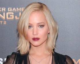 Eek! Jennifer Lawrence gives us an eyeful of her lacy bra at Hunger Games screening. Pics: