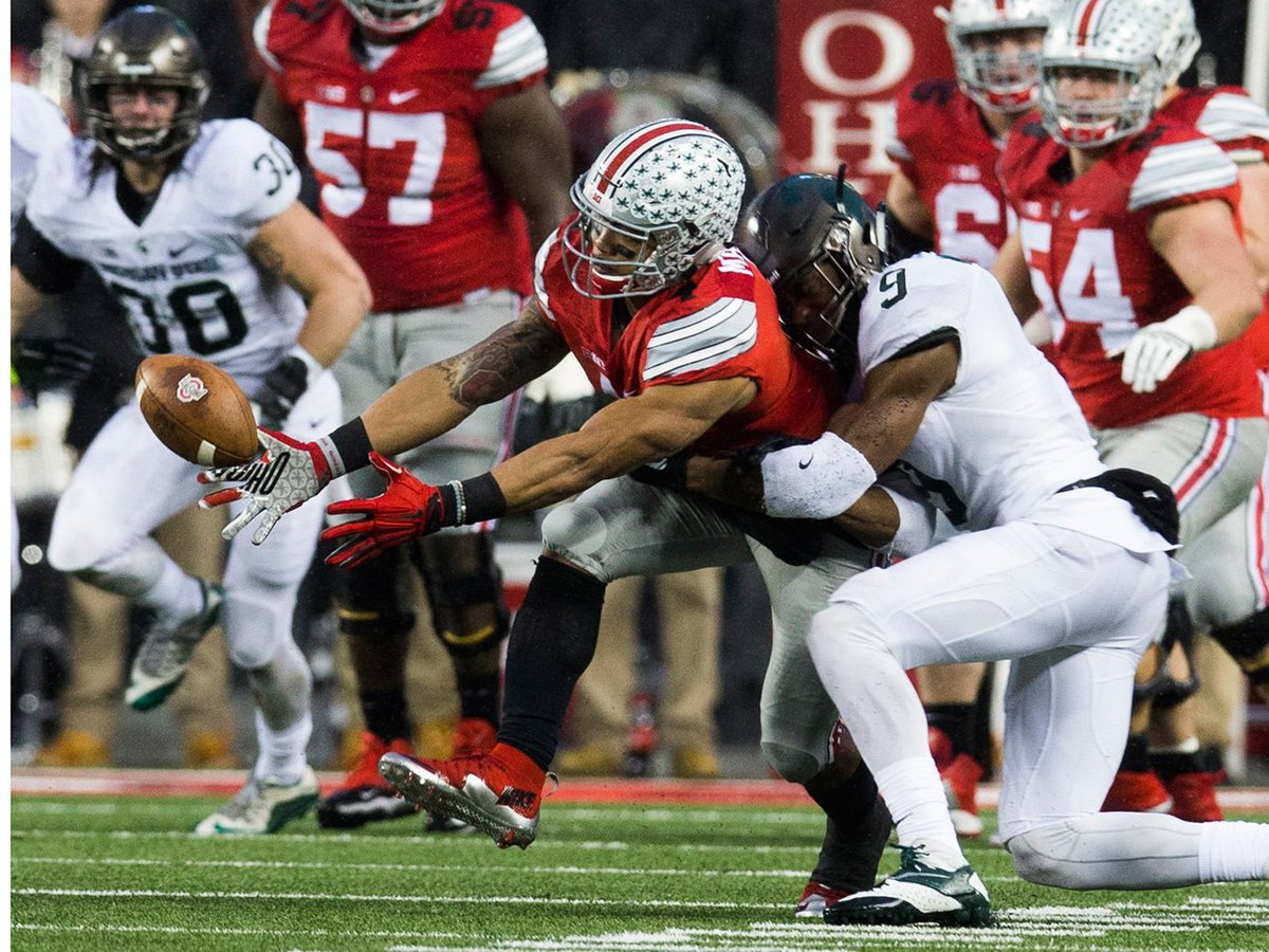 Spartans ruin Buckeyes' title defense chances; OK St. falls; top 25 NCAA football roundup -